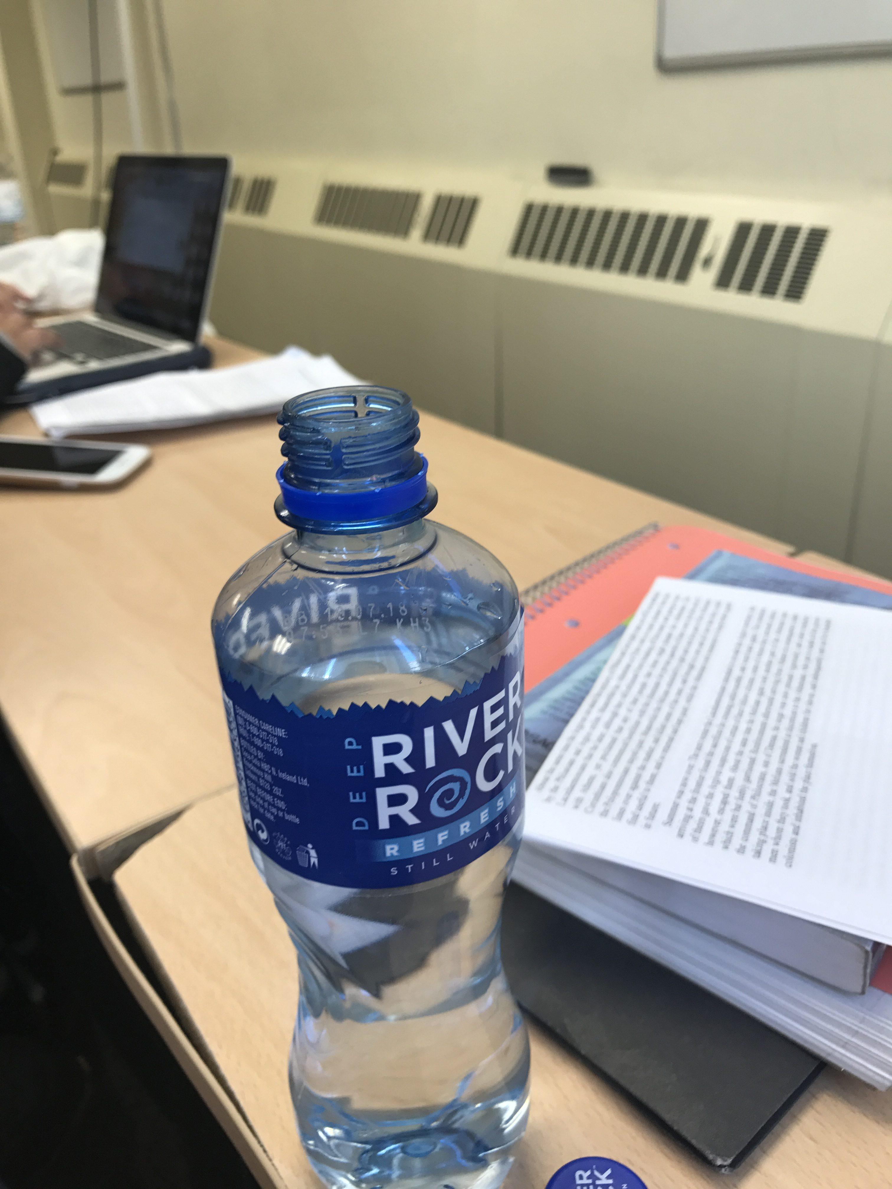 desk, water bottle, white board,