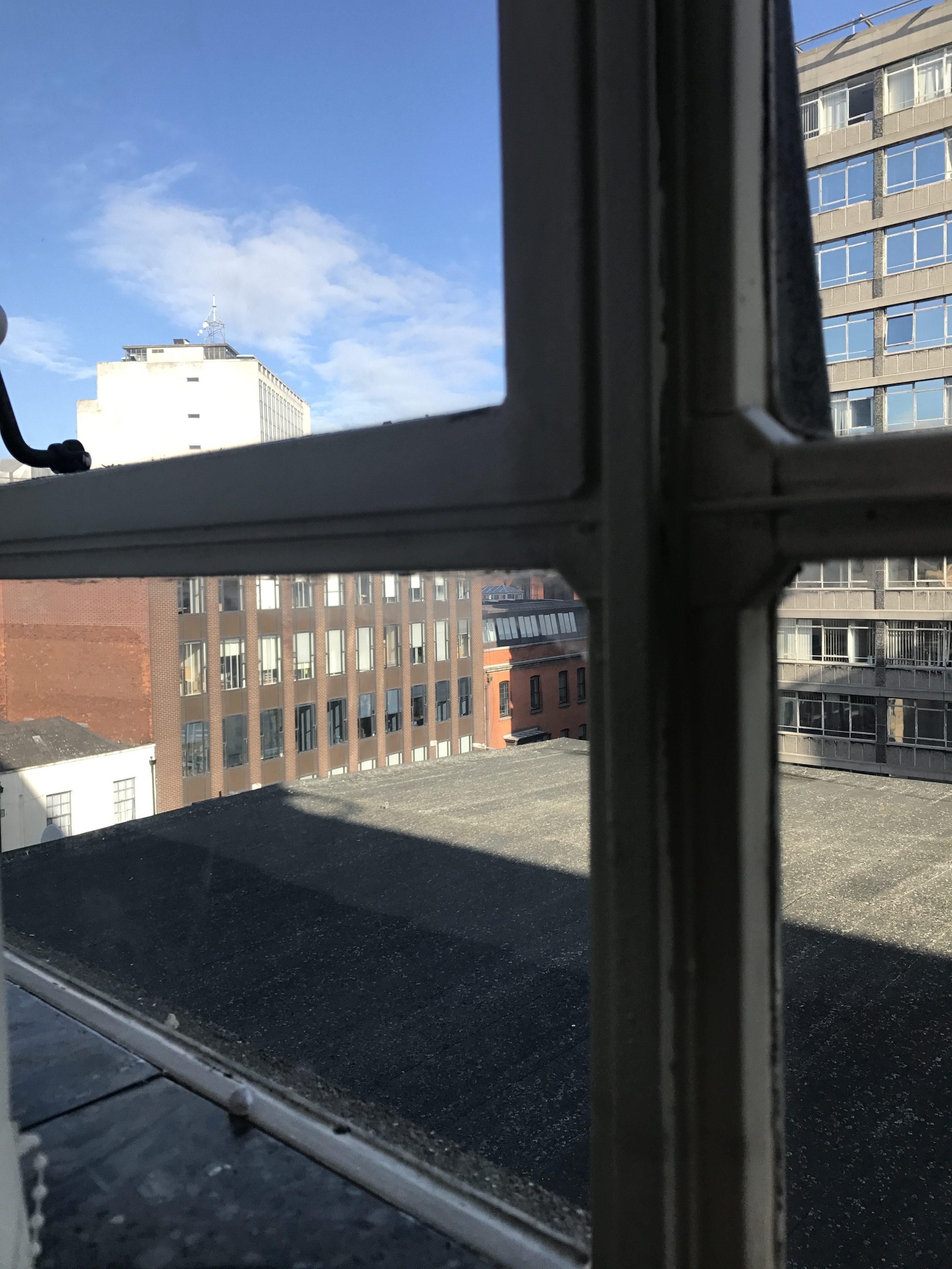 window, cityscape, blue skies