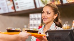service industry worker in fast food smiling