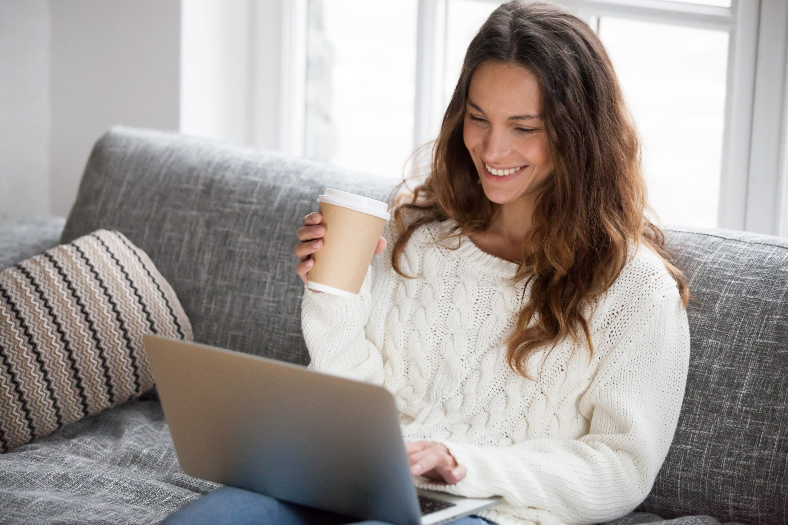 woman on laptop with coffee